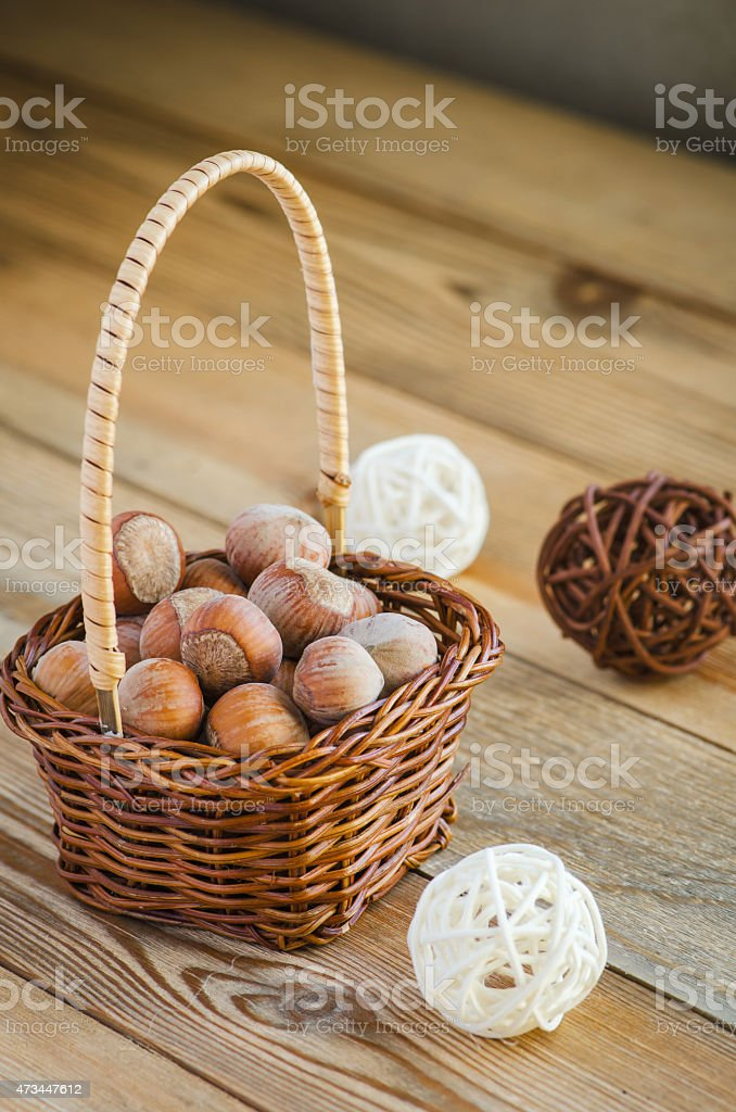 hazelnuts in the basket stock photo