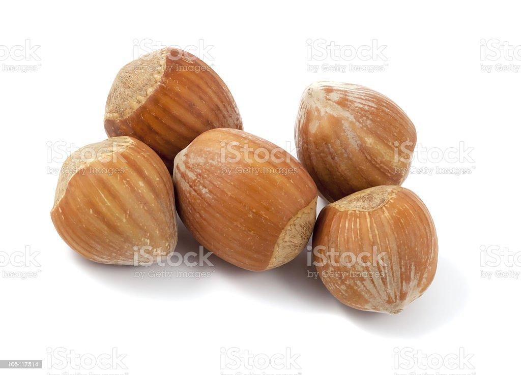 Hazelnuts isolated on white background. Macro photo. royalty-free stock photo