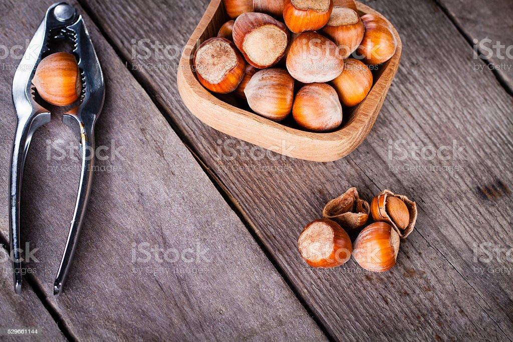 Hazelnuts on a wooden background. stock photo