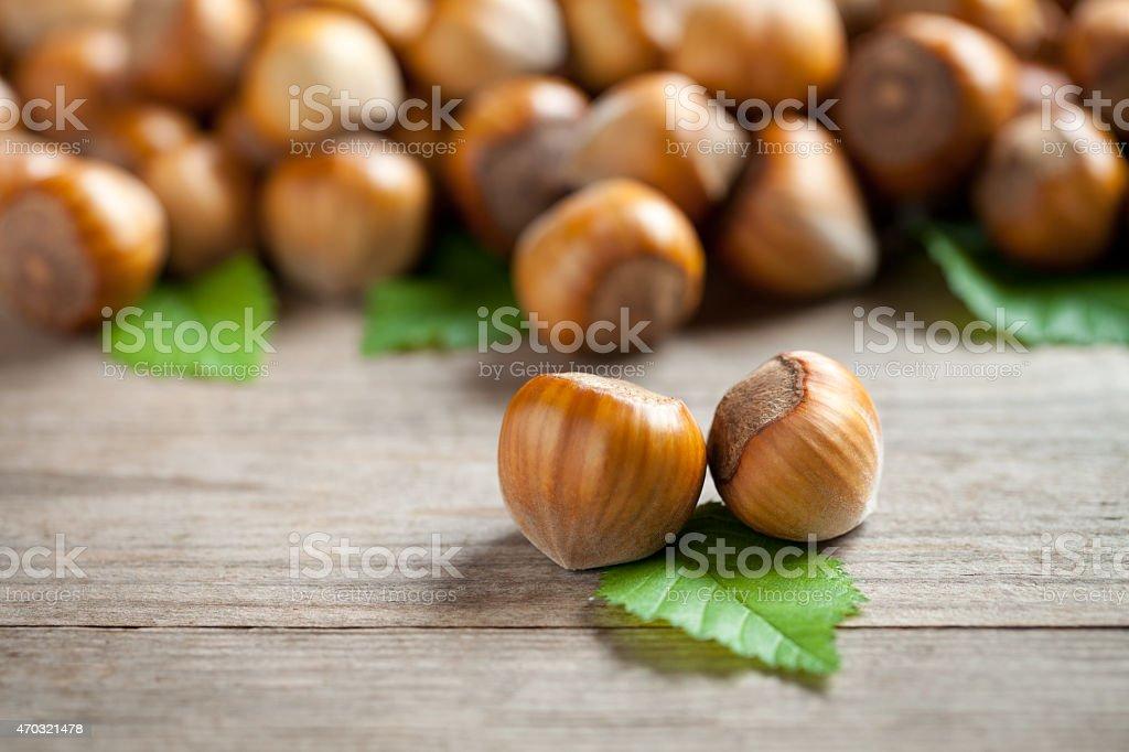 Hazelnuts on old table stock photo