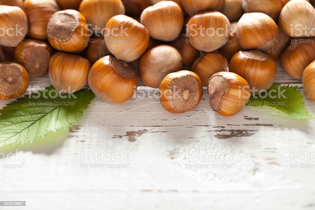 Hazelnuts on white table stock photo