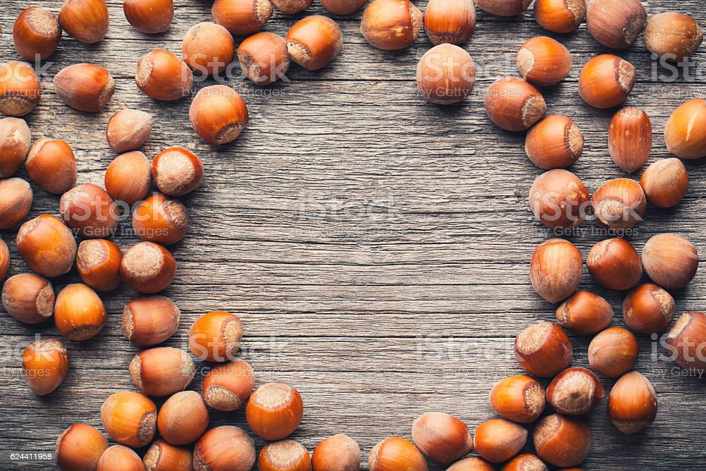 Hazelnuts on wood table with copyspace stock photo