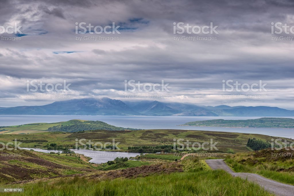 Hazy Arran and Summer Clouds stock photo