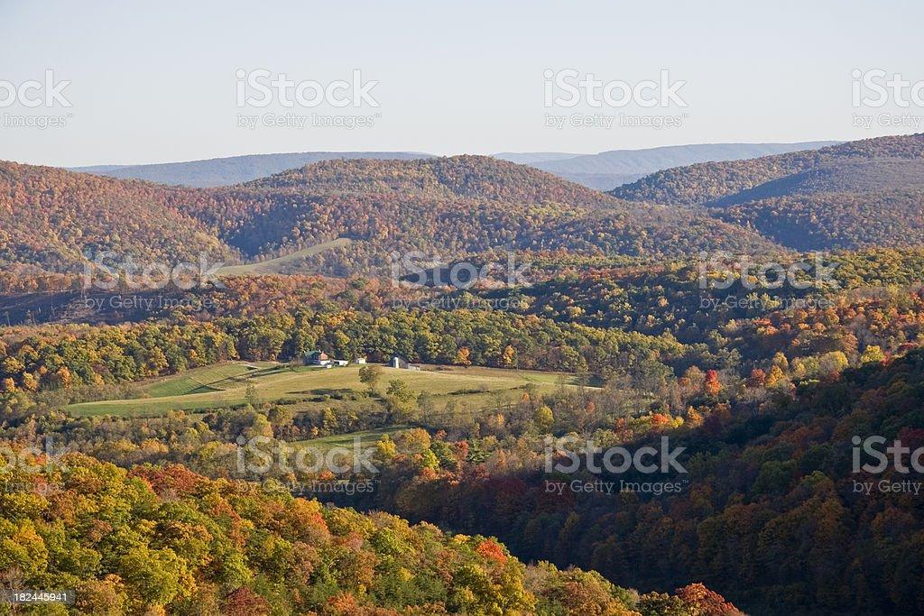 Hazy Autumn Mountain and Valley Scene royalty-free stock photo