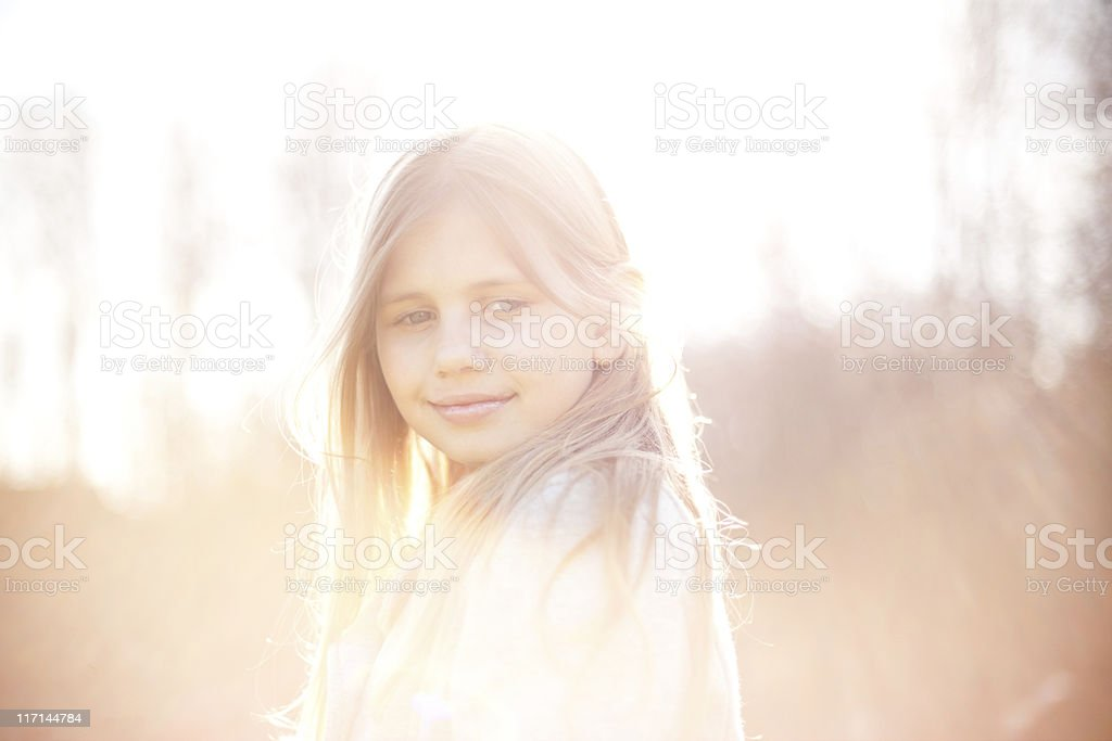 Hazy Backlit Image of a Young Girl stock photo