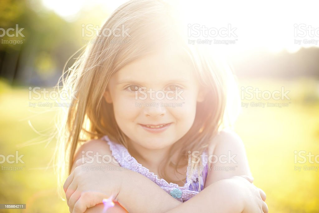 Hazy Backlit Sunflared Image of a Young Girl royalty-free stock photo