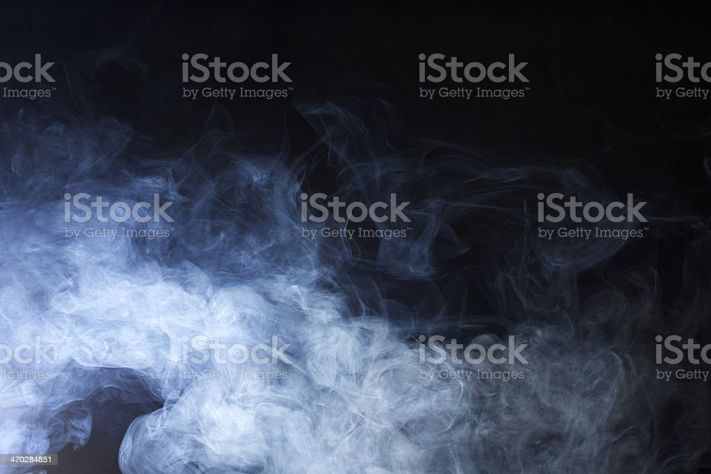 Hazy Blue Smoke on Black Background stock photo