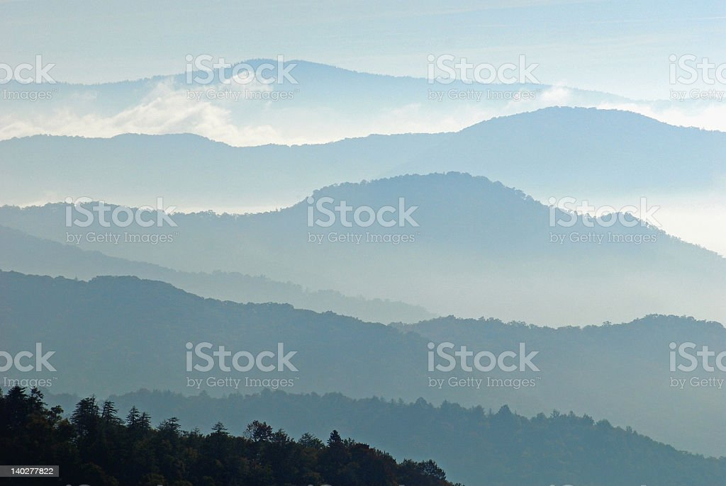 Hazy landscape image of mountains stock photo