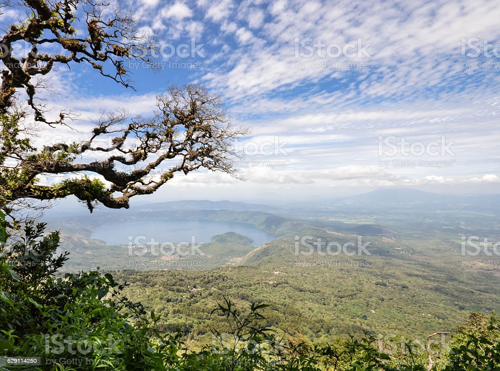 Hazy landscape of the volcanic caldera Lake Coatepeque in Salvad stock photo