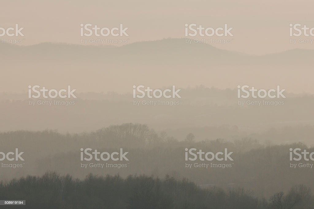 Hazy mountain landscape in sunset stock photo