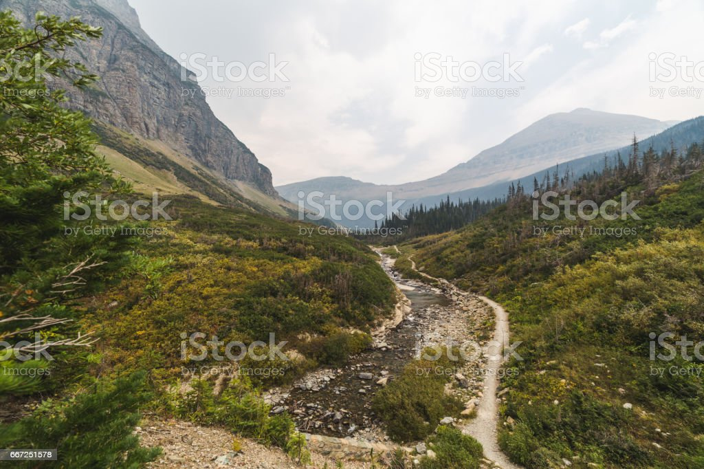 Hazy Mountain Valley with Trail and River stock photo