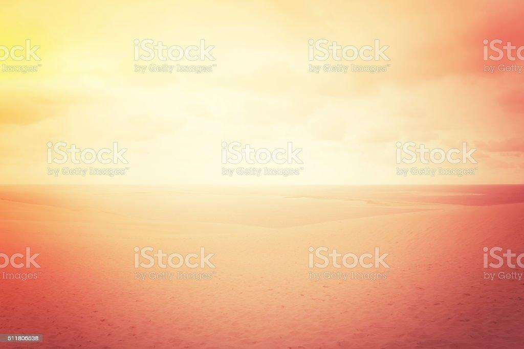 Hazy sand dunes in red glow stock photo
