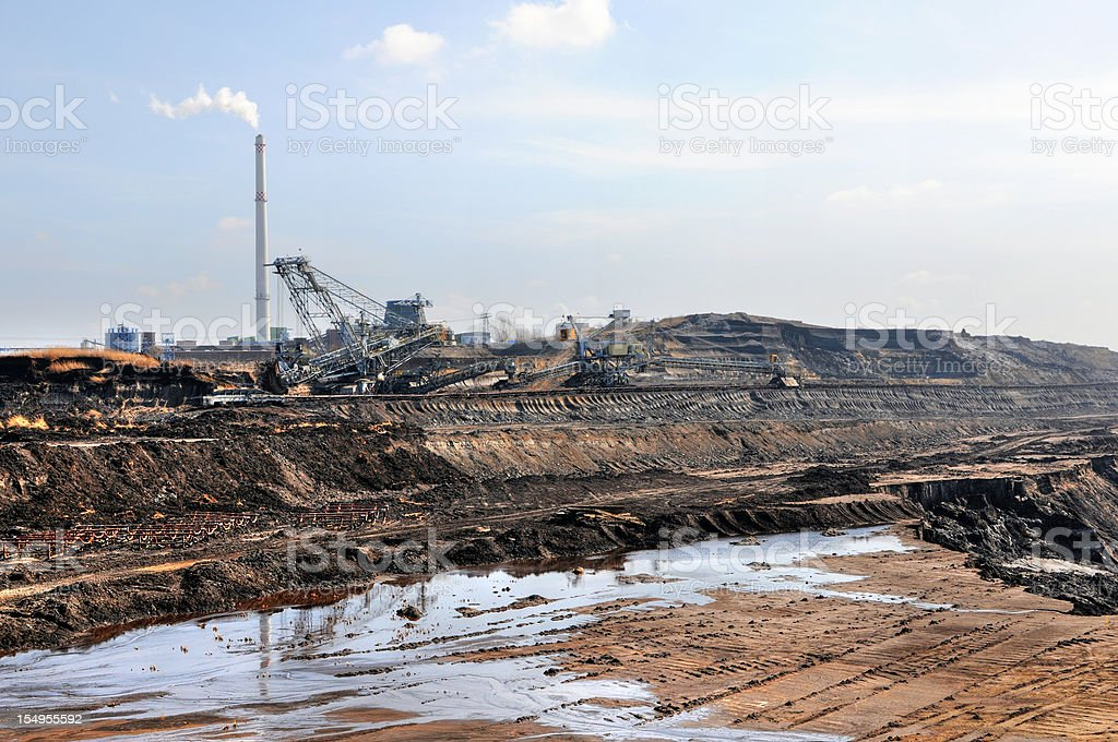 hdr of open Strip Coal mine with smoke stake fumes stock photo