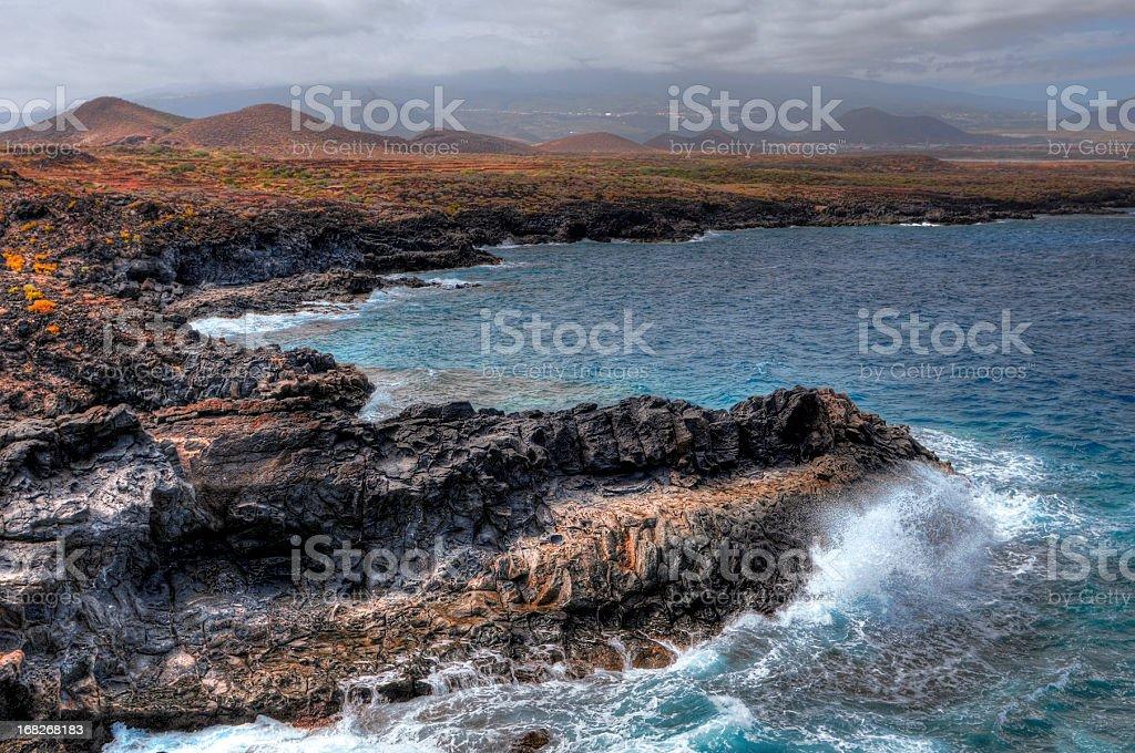 hdr of surf at montana amarilla atlanic coast tenerife spain stock photo