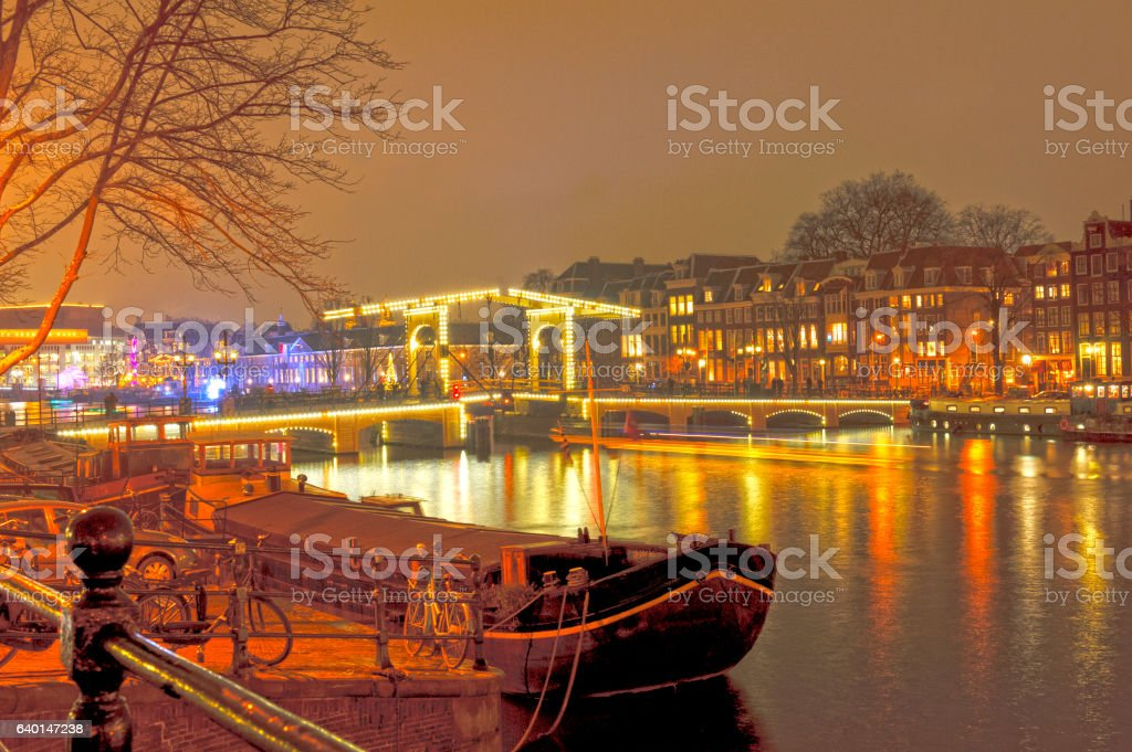 hdr photo of skinny bridge amsterdam at night stock photo