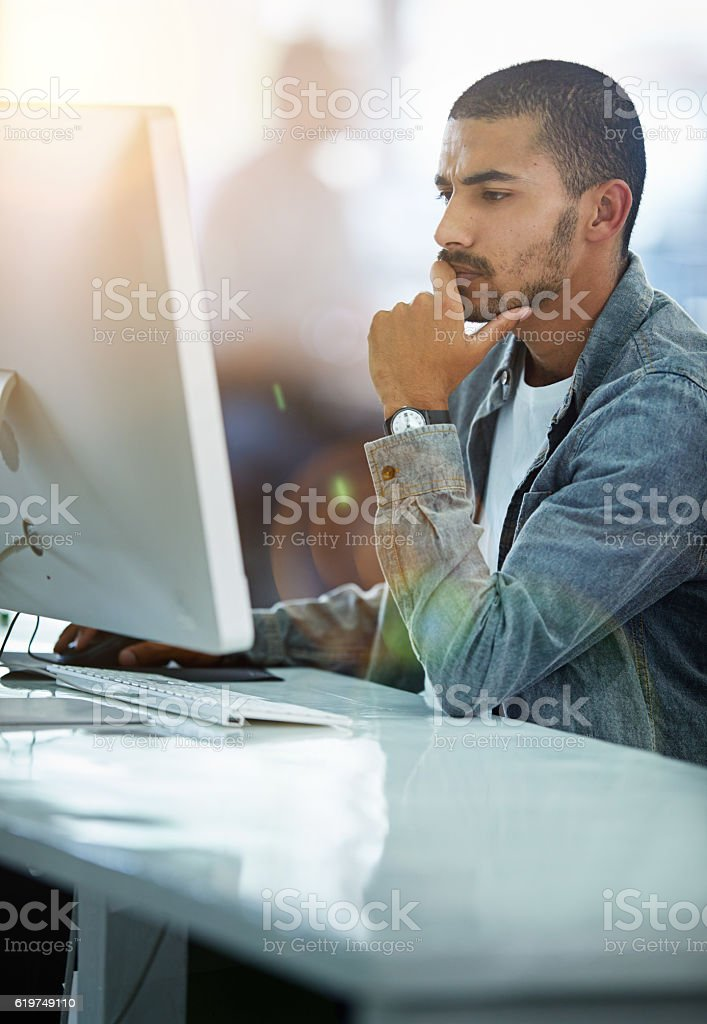 He always gives his work one hundred percent focus stock photo