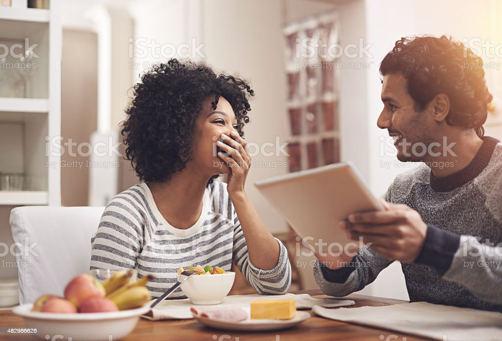 He always makes her laugh stock photo