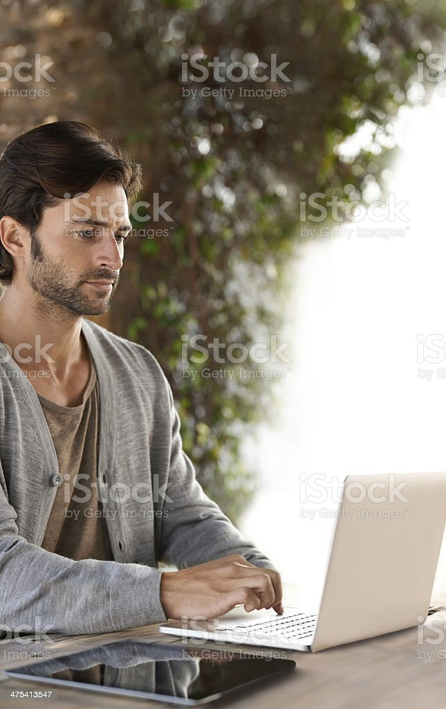 He can work anywhere and anytime royalty-free stock photo