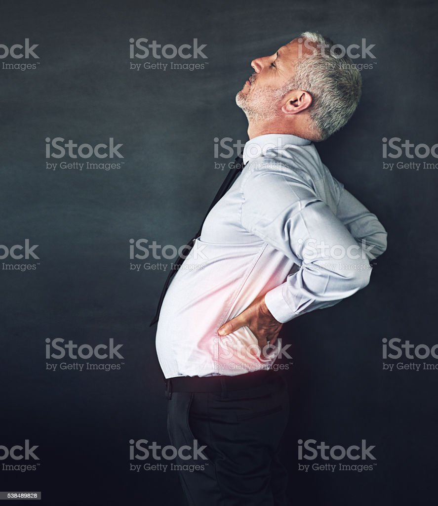 He carries his stress in his back stock photo