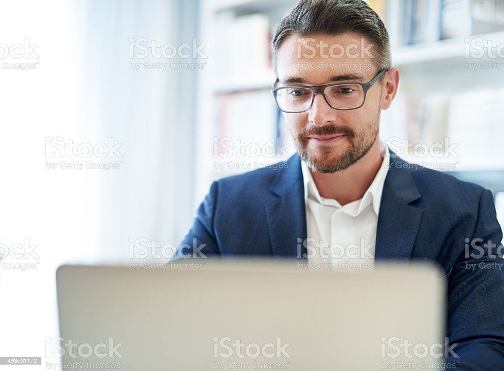 He does all his work online stock photo