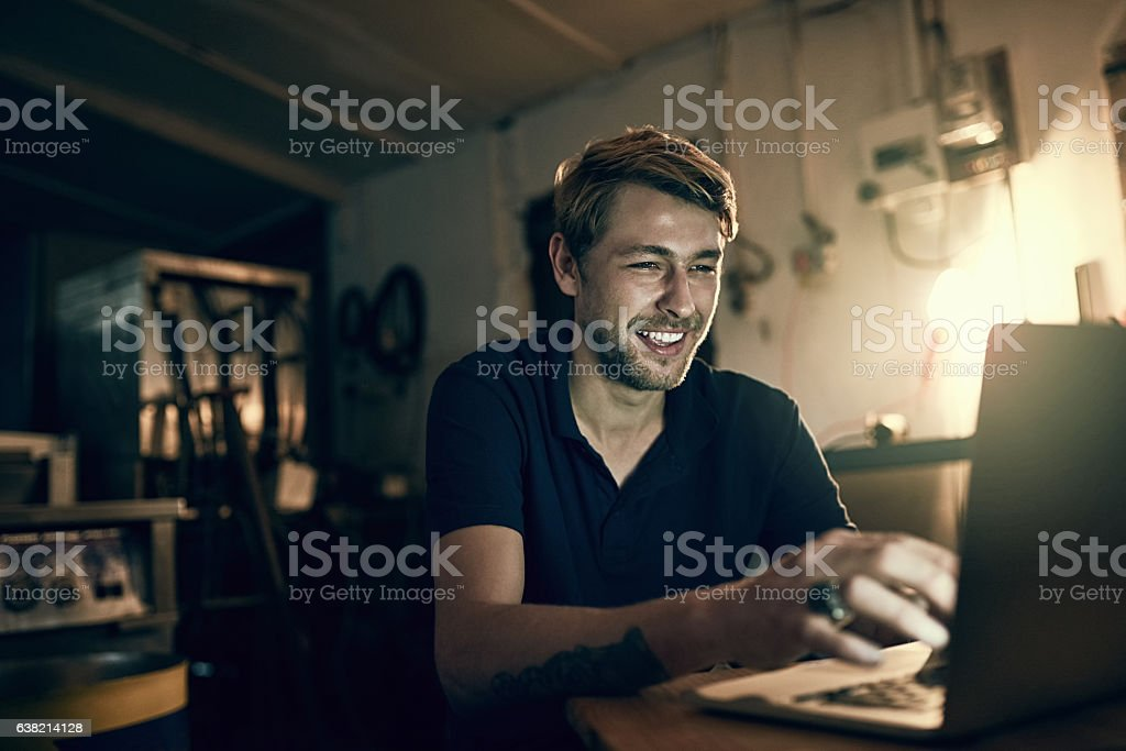 He doesn't mind burning the midnight oil stock photo