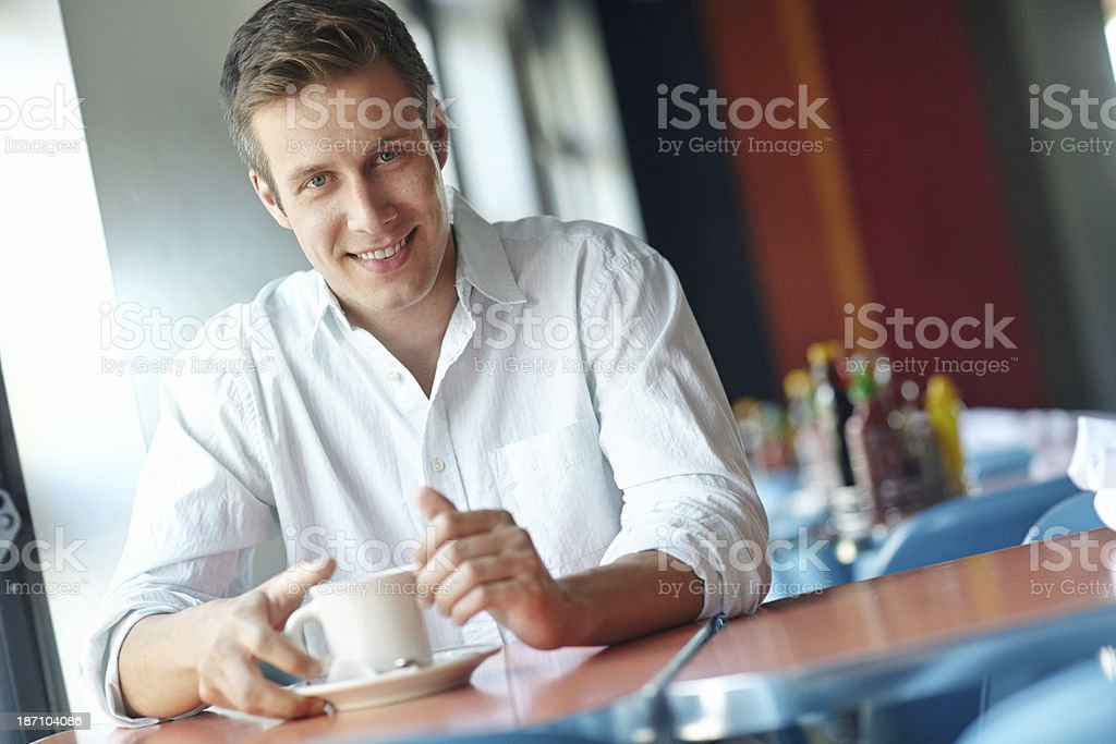 He enjoys a good cup of coffee royalty-free stock photo