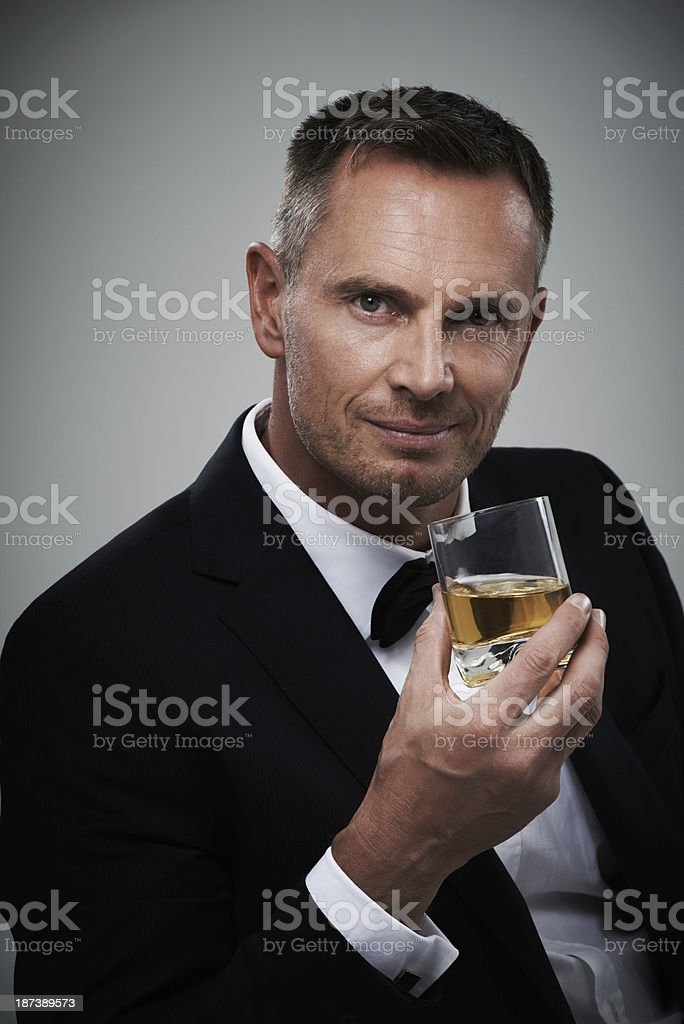 He enjoys a well-aged scotch royalty-free stock photo