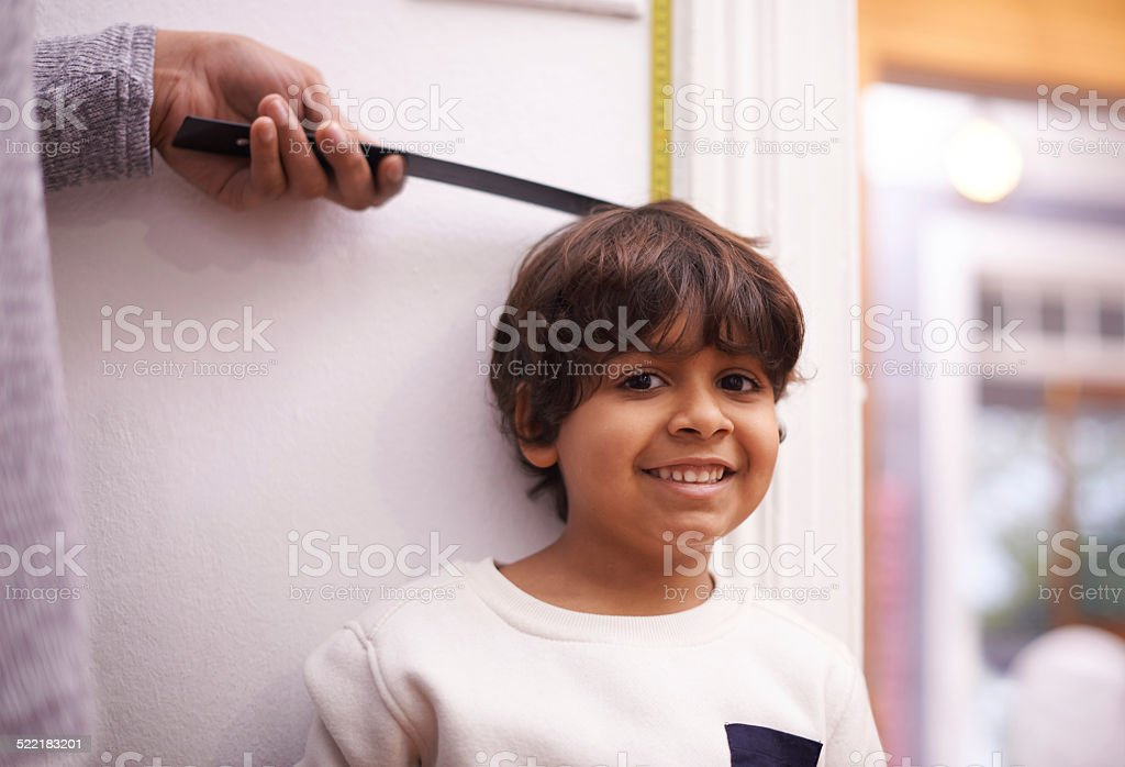 He gets taller by the day stock photo