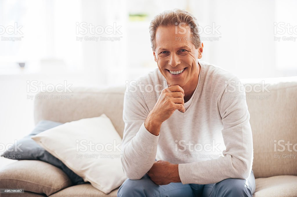 He got candid smile. stock photo