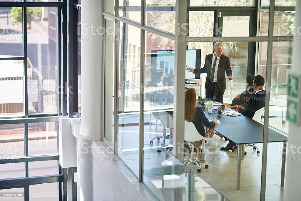 He guides his staff by example stock photo
