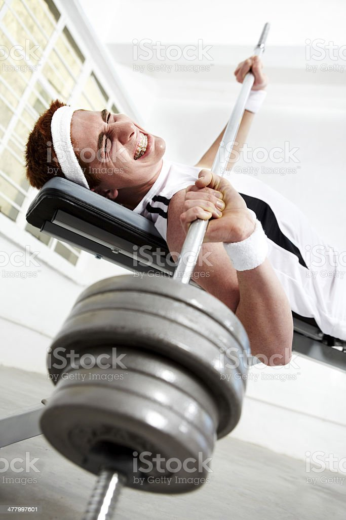 He has a big weight on his chest stock photo
