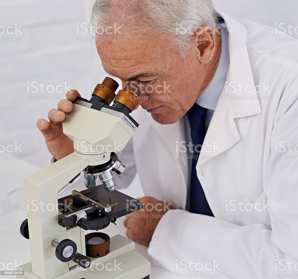 He has a keen eye for science stock photo