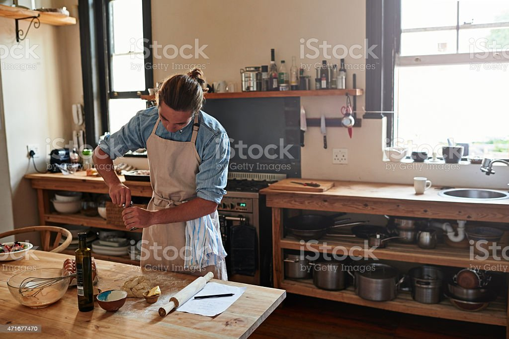 He has a passion for baking stock photo