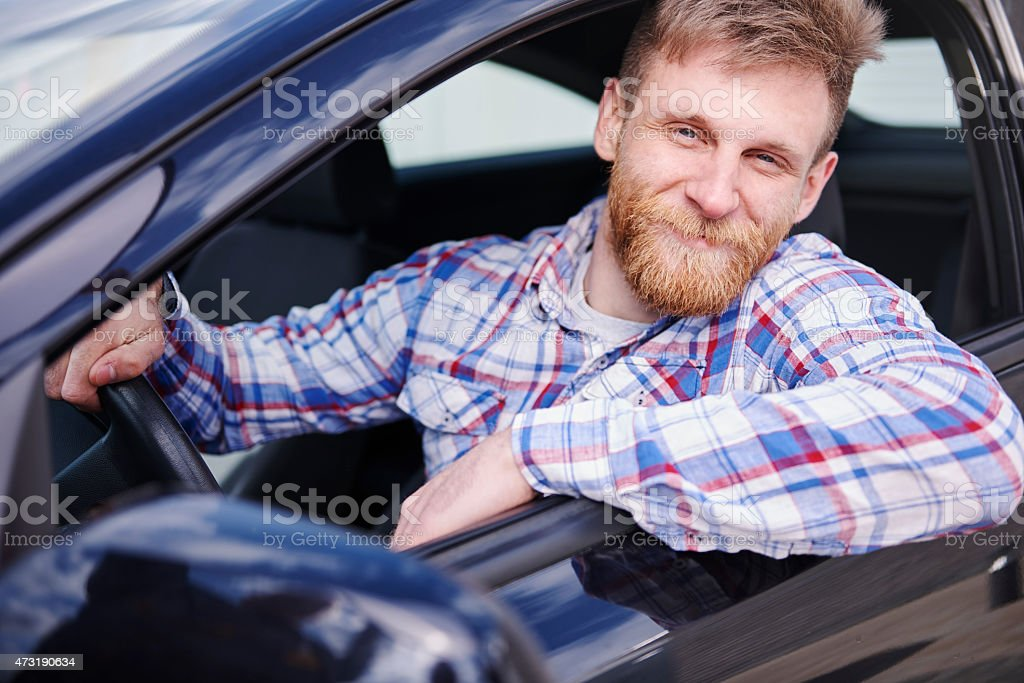 He is proud from first car stock photo