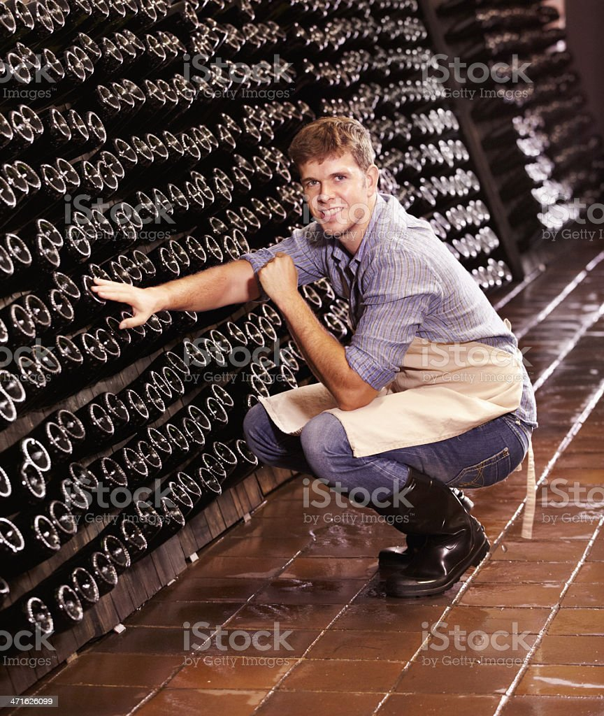 He keeps a close eye on his wine stock photo