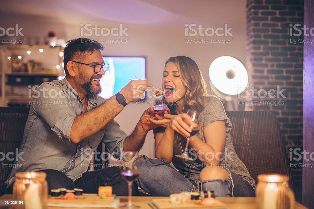 He knows how to win her heart stock photo