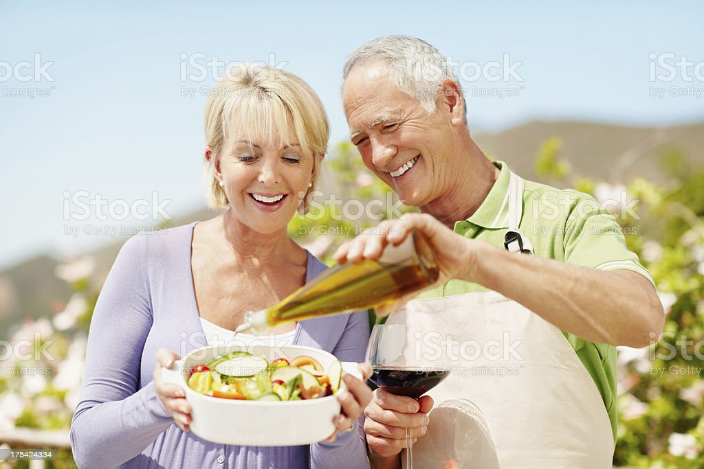 He knows just the way I like my salad! royalty-free stock photo