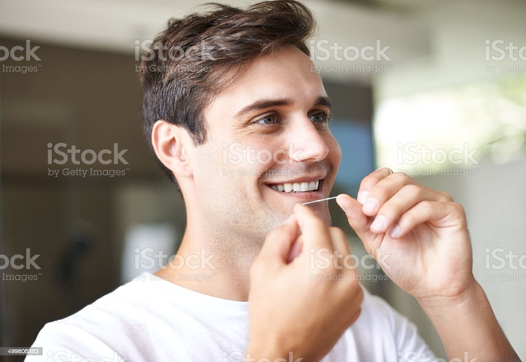 He know's the importance of dental hygiene stock photo