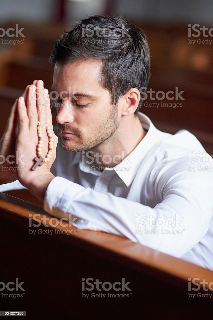 He knows where his strength comes from stock photo