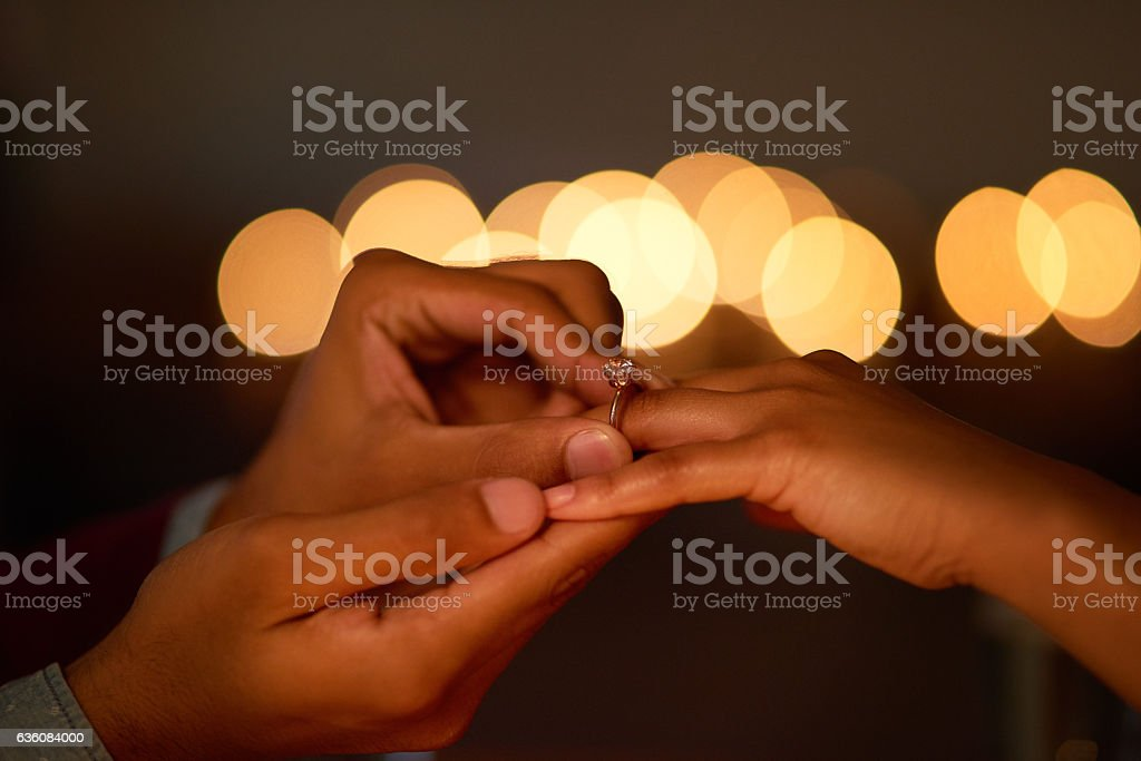 He liked it so he put a ring on it stock photo
