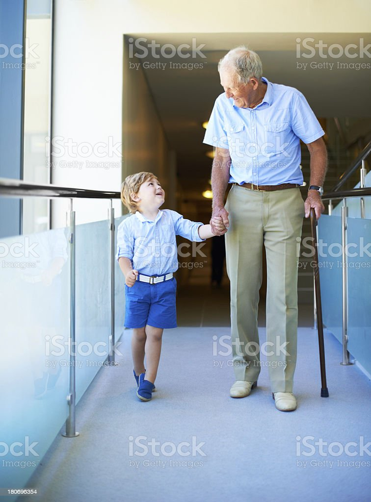 He looks up to his grandfather royalty-free stock photo