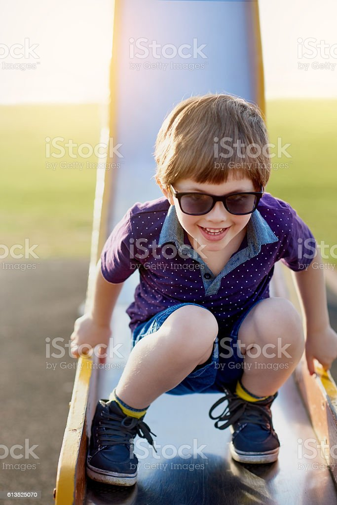 He loves coming to the playground stock photo