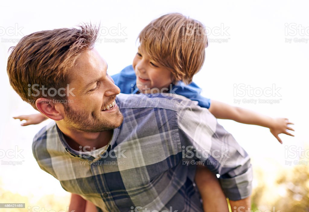 He loves his little boy so much stock photo