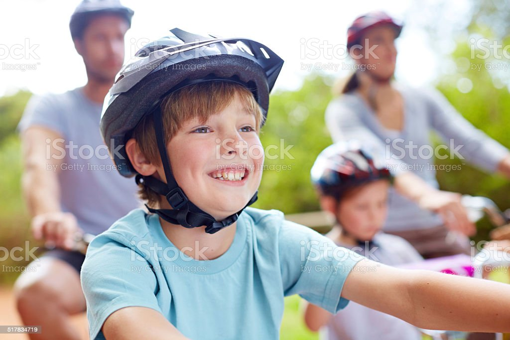 He loves riding his bicycle stock photo