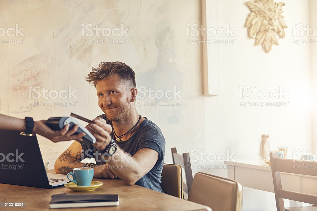 He loves the whole 'tap to pay' thing stock photo