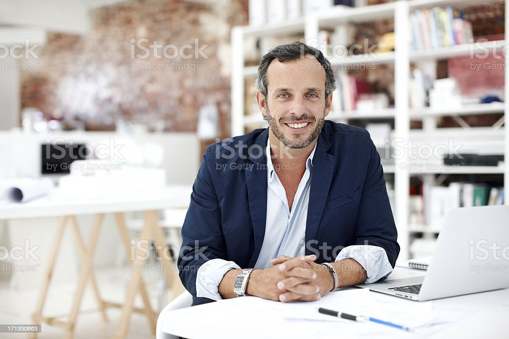 He loves working in the design industry stock photo