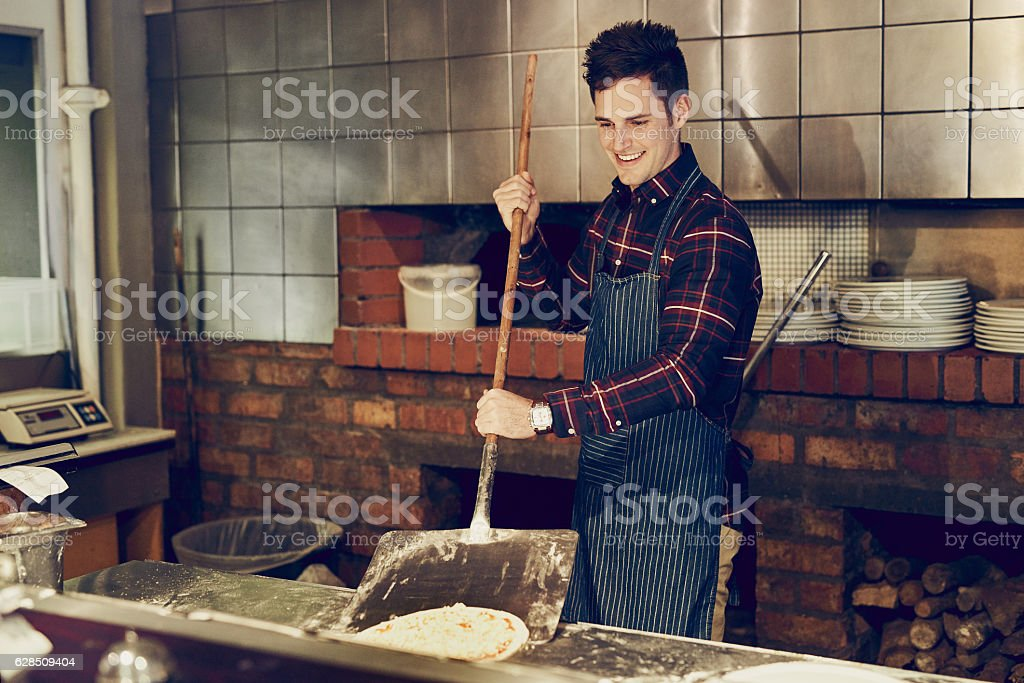He makes pizza to perfection stock photo