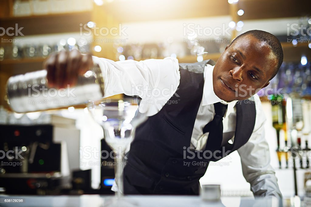 He makes the best cocktails stock photo