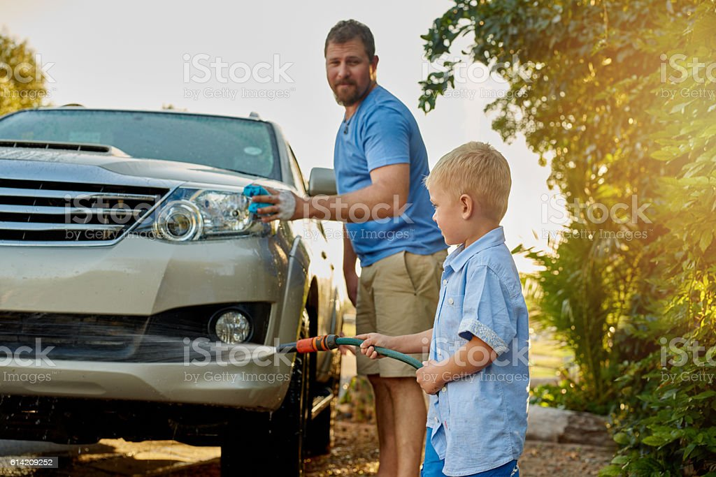 He may be young but he's still very helpful stock photo