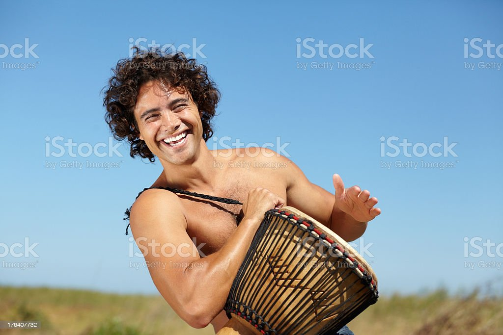 He moves to the rhythm of his own drum stock photo